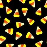 Modèle sans couture de Halloween avec des sucreries sur le noir illustration stock
