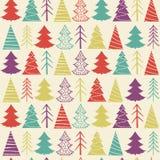 Modèle sans couture de Noël avec les sapins colorés Photographie stock libre de droits