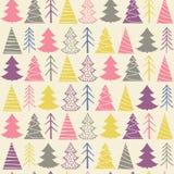 Modèle sans couture de Noël avec les sapins colorés Image stock