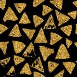 Modèle sans couture de triangles avec la texture d'or de scintillement Photos libres de droits