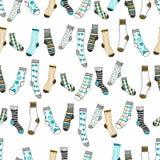 Modèle sans couture des chaussettes de doddle sur un fond blanc vêtement Photos stock