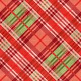 Modèle sans couture diagonal principalement dans des tonalités rouges Image libre de droits