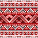 Modèle sans couture ethnique avec des couleurs noires, blanches, rouges illustration libre de droits