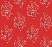 Modèle sans couture floral blanc sur un fond rouge Photo stock
