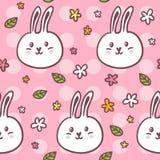 Modèle sans couture mignon avec des lapins et des fleurs de griffonnage Photo stock