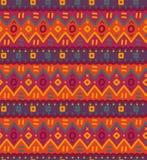 Modèle sans couture rayé ornemental indigène décoratif lumineux de textile ethnique Images libres de droits