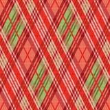 Modèle sans couture rhombique principalement dans des tonalités rouges Images stock