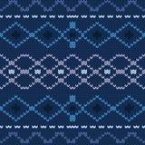 Modèle sans couture tricoté traditionnel scandinave bleu d'hiver Fond pour des cartes de Noël et de nouvelle année Photos libres de droits
