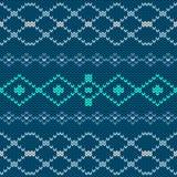 Modèle sans couture tricoté traditionnel scandinave bleu d'hiver Fond pour des cartes de Noël et de nouvelle année Photographie stock libre de droits