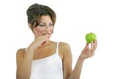 Modèle sexy avec la pomme Photo stock