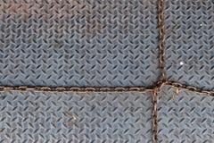 Modèle T sur la surface métallique Image stock