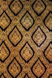 Modèle traditionnel de peinture d'art de style de la Thaïlande d'un dieu sur le noir et la couleur d'or Images stock