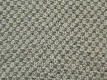 Modèle tricoté avec des aiguilles Photo stock