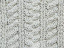 Modèle tricoté par blanc Photo stock