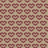 Modèle tricoté sans couture avec les coeurs rouges Photographie stock