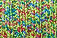 Modèle tricoté sur les vêtements de laine, fond, papier peint Photographie stock libre de droits