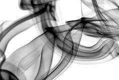 Modèles abstraits noirs de vapeur sur le blanc Photographie stock libre de droits