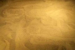 Modèles abstraits sur le sable photos stock
