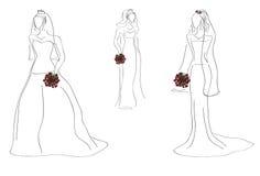 Modèles avec les robes nuptiales Photos libres de droits