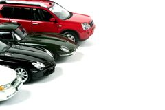 Modèles d'échelle des voitures sur un fond blanc Images stock