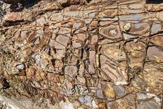 Modèles d'oxyde de fer dans la roche de grès, Bude, les Cornouailles images stock