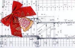 Modèles de conception d'architecte et dessins de projet sur le fond de Noël de table Photographie stock libre de droits
