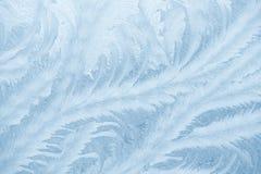 Modèles de Frost sur le verre de fenêtre dans la saison d'hiver Texture en verre givré Fond pour une carte d'invitation ou une fé photos stock