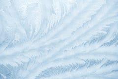 Modèles de Frost sur le verre de fenêtre dans la saison d'hiver Texture en verre givré Fond pour une carte d'invitation ou une fé photos libres de droits