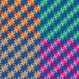 Modèles de plaid de puzzle dans quatre Colorways Photographie stock