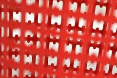 Modèles en plastique rouges sans couture Photos libres de droits