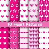 10 modèles sans couture de vecteur de coeur Couleurs roses et blanches Photographie stock