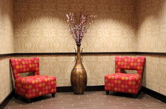 Mod chairs and vase in upscale hotel Royalty Free Stock Photos
