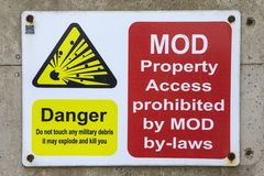 MOD Property Access Prohibited. A danger sign warning people that access is prohibited due to possible explosive debris royalty free stock photography