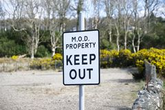 MOD property keep out sign security and protection ministry of defence navy army government base uk. Uk royalty free stock photos