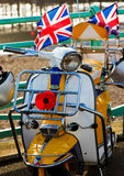 Mod scooter with Union Jack flags. Retro Mod scooter with Union Jack flags and red poppy Royalty Free Stock Photos