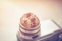 Mod for vaping device and dripping RDA without top cap, coils. Electronic. E - cigarette,  vaporizer, vape, for quit smoke e-liquid. Vintage toned image Stock Photos