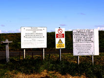 MOD Warning signs, The Wash, Lincolnshire. Ministry of defence Warning signs against a public footpath on the Wash, Lincolnshire, England, UK Royalty Free Stock Images
