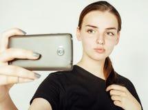 Młoda ładna nastoletnia dziewczyna robi selfie odizolowywającemu up na białym tła zakończeniu Zdjęcia Stock