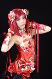 Młoda azjatykcia dziewczyna ubierająca w cosplay kostiumu Zdjęcia Stock