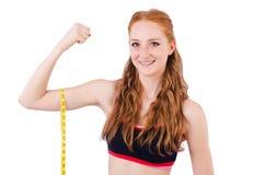 Młoda dziewczyna z centymetrem Fotografia Stock