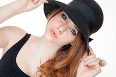 Moda hermosa adolescente en maquillaje y sombrero Imagen de archivo
