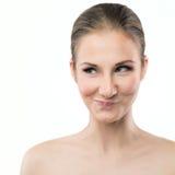 Młoda kobieta robi śmiesznemu twarzy wyrażeniu Fotografia Royalty Free