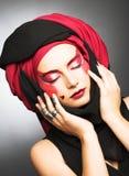 Młoda kobieta z kreatywnie makijażem Obrazy Stock