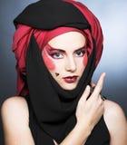 Młoda kobieta z kreatywnie makijażem Fotografia Stock