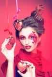 Młoda kobieta z kreatywnie makijażem Zdjęcia Royalty Free