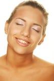 Młoda kobieta z szczęśliwym uśmiechem Obraz Stock