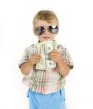 Młoda śliczna chłopiec trzyma udział gotówka, amerykanin Zdjęcia Royalty Free