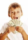 Młoda śliczna chłopiec trzyma udział gotówka, amerykańscy dolary Zdjęcia Stock