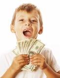 Młoda śliczna chłopiec trzyma udział gotówka, amerykańscy dolary odizolowywający Zdjęcia Royalty Free