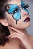 Moda Uzupełniał. Motyli makeup na twarzy pięknej kobiecie. Sztuka P Zdjęcia Royalty Free